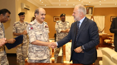 Qatari naval commander Major General Mohammed Nasser Al Mohannadi and Managing Director MBDA Italia Antonio Perfetti shake hands after the contract signature