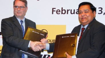 Mr. A M Naik and Antoine Bouvier  shaking hands after the joint venture agreeement signing