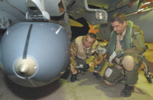 Photograph shows Wing Commander Dave Robertson, right and Squadron Leader Andy Myers prior to their departure on a Tornado GR4 night mission over Iraq armed with the RAF's new stand off precision guided missile 'Storm Shadow'. Photograph by Corporal Craig Fryer RAF Combat Camera Crown Copyright