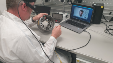 Engineer wearing Smart Glasses whilst working with a designer over a Skype video call.